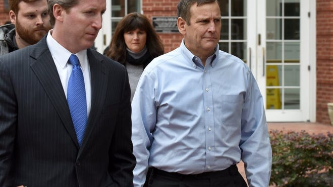 Former Pilot Flying J Vice President of Direct Sales Scott Wombold, right, leaves federal court after being arraigned on charges including conspiracy to commit wire fraud and mail fraud. Seven other Pilot employees also were named in the 14-count indictment.