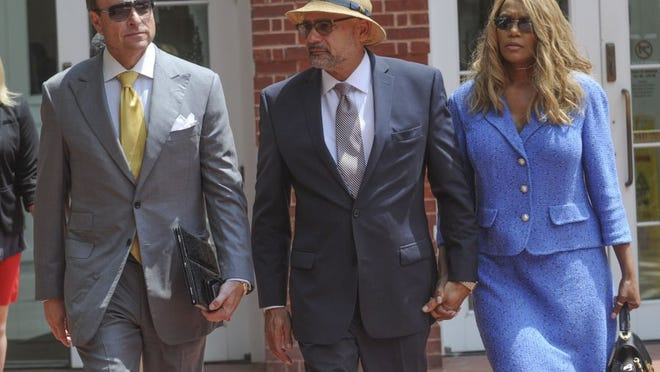 State Rep. Joe Armstrong, center, with his wife, LeTonia, and attorney Gregory Isaacs, leaves court after being found guilty of one felony count in his tax fraud trial Monday, Aug. 8, 2016, at the Howard H. Baker Jr. U.S. Courthouse. The jury acquitted Armstrong of two other counts. He was charged with conspiring with accountant Charles Stivers to hide the profit from a cigarette tax stamp hike that Armstrong helped pass. (PAUL EFIRD/NEWS SENTINEL)