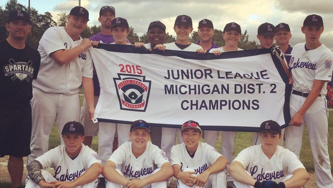 Members of the Lakeview Youth Association junior team celebrate their 2015 district championship.