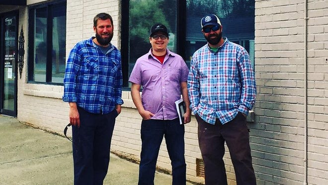 Fork & Plough owners, from left to right Roddy Pick, Shawn Kelly and Chad Bishop, stand in front of the building that will become their local-focused restaurant, butchery and market.