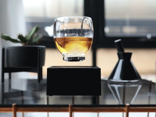 Your eyes are not deceiving you -- this glass really is levitating.