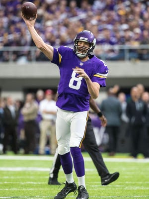 Minnesota Vikings quarterback Sam Bradford (8) throws a touchdown pass to wide receiver Adam Thielen (not pictured) during the first quarter against the Arizona Cardinals at U.S. Bank Stadium.