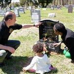Town of Lloyd Police Lieutenant James Janso attempts to comfort Fortunate Higgins as she arrives at the LaGrange Cemetery to visit the grave of her son Elijah Williams on Dec. 4, 2015.