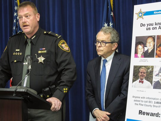 Pike County Sheriff Charles Reader, left, discusses