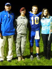 Father Pat, daughter Kayla, son Kyle and mother Nancy Keehan take part in Senior Night festivities at halftime of a Gibraltar football game last fall.