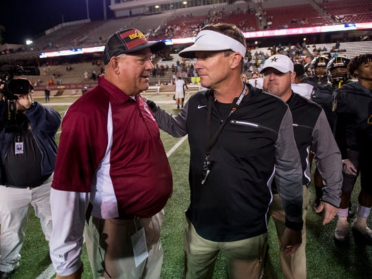 Autauga Academy coach Bobby Carr, right, and Escambia Academy coach Hugh Fountain talk after the AISA Class AA State Championship Football game in Troy, Ala. on Friday November 17, 2017.