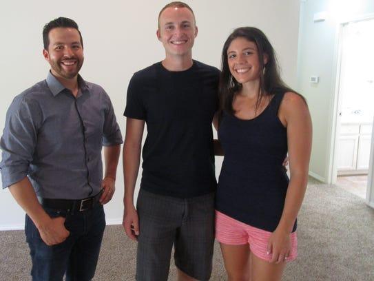 Real estate agent Benjamin Beaver (from left) helps