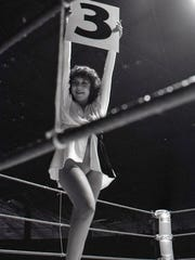 Ring girl at the Baddest Man in Town competition on July 14, 1980.