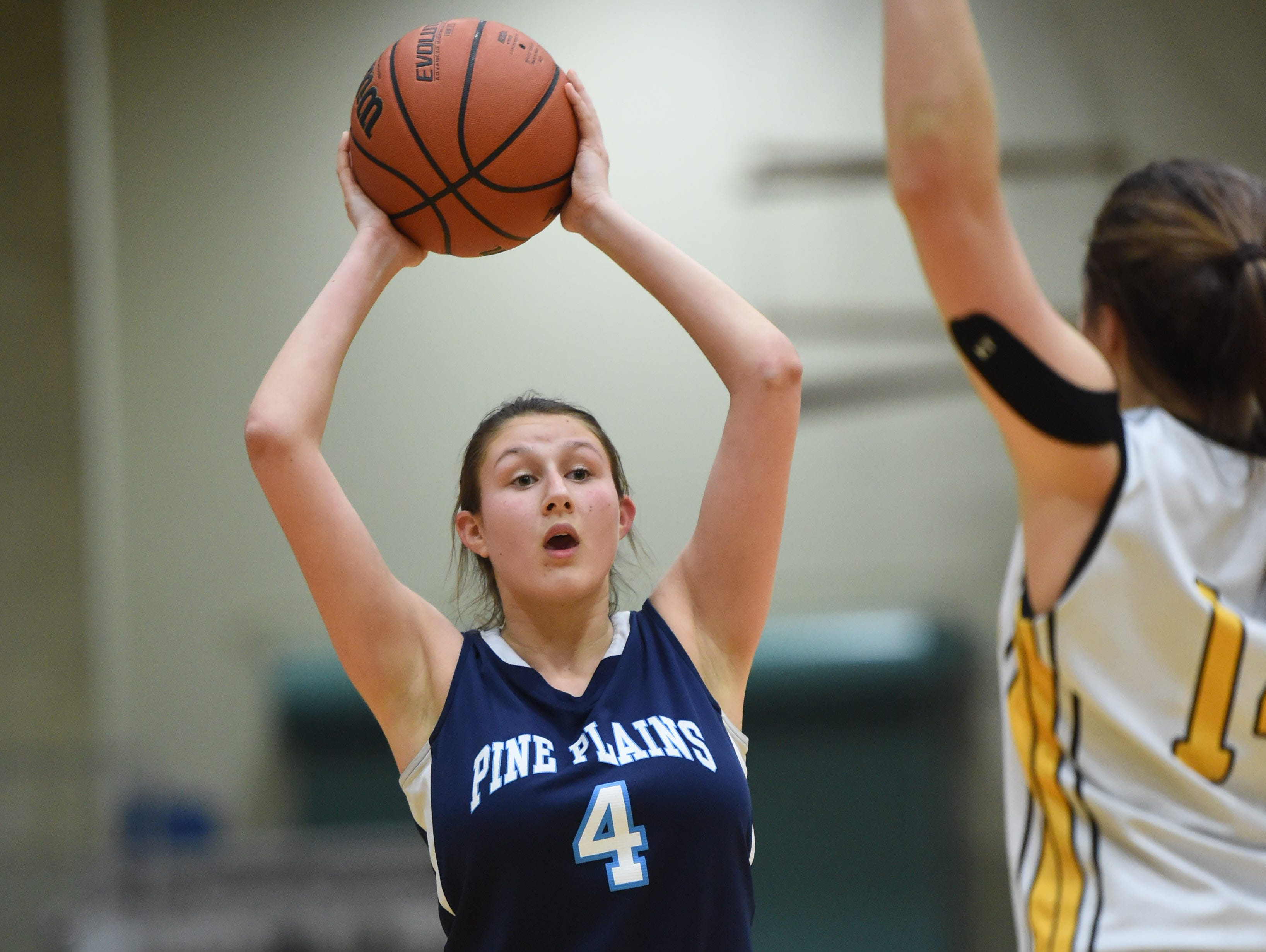 Pine Plains' Tia Fumasoli looks to pass the ball away from South Seneca's Skylar Shaulis during the Class C New York State Championship game at Hudson Valley Community College in Troy on March 13.