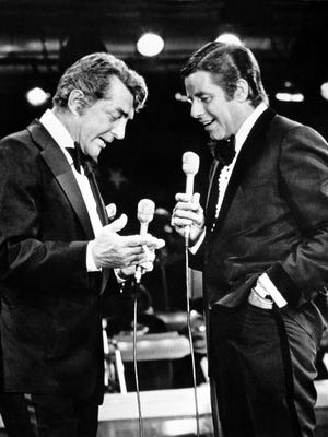 Entertainers Dean Martin, left, and Jerry Lewis appear together on Lewis's annual telethon for the Muscular Dystrophy Association in Las Vegas, Nev on Sept. 7, 1976.