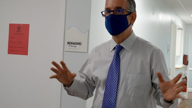 Dr. James Goldenberg shows the secure room where COVID-19 vaccines are stored at the JFK Medical Center in Atlantis. Trials of the drug will begin Tuesday at the clinic.