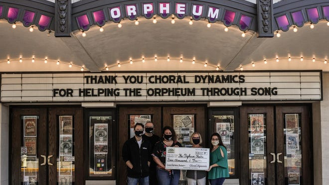 Since early July, Choral Dynamics has been featuring songs from previous shows on their Facebook page on a bi-weekly basis, giving all donations to the Orpheum Theatre. Pictured from left are Orpheum staff members Ross McIntire, Tim Holmes and Erin Glasnovich, and Choral Dynamics members Mary Stiers and Liz Cross.