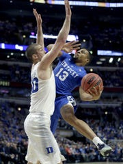 Kentucky guard Isaiah Briscoe (13) drives on Duke center Marshall Plumlee during the first half of an NCAA basketball game Tuesday, Nov. 17, 2015, in Chicago. (AP Photo/Nam Y. Huh)