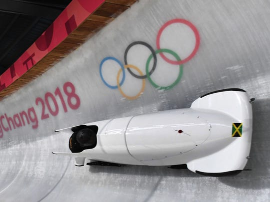Team leader and driver Jazmine Fenlator-Victorian of Jamaica corners in the second women's unofficial bobsleigh training session. Jamaica won't have this sled, but it will have a different sled.