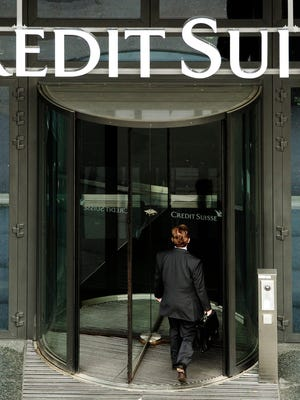 May 2010 file photo shows a man entering a Credit Suisse bank office in Zurich, Switzerland.