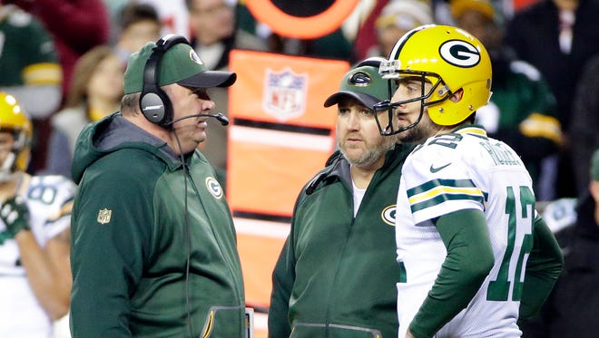 Packers coach Mike McCarthy talks with quarterback Aaron Rodgers (12) on the sidelines during the game against the Washington Redskins at FedEx Field.