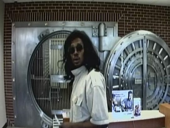 A man wearing a black wig is the lone suspect in a