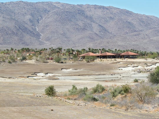 The 18th hole and clubhouse at Rams Hill Country Club in Borrego Springs. The golf course has not been watered since the former owner sold the well to the Borrego Water District.