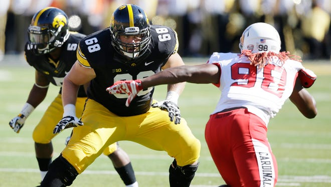 Iowa offensive linesman Brandon Scherff (68) looks to make a block during the first half of an NCAA college football game against Ball State, Saturday, Sept. 6, 2014, in Iowa City, Iowa.