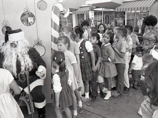 Kids wait in line for their turn with Santa at Peppermint Lane in downtown Corpus Christi on Nov. 26, 1965.