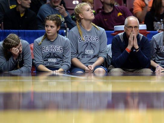 Becker assistant coach Scott Gudmundson stares across