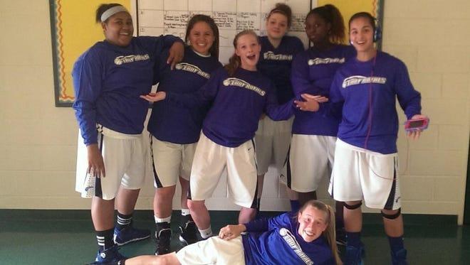 The Lady Royals ninth grade basketball team.