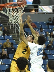 Bishop Manogue's Daniel Bansuelo shoots with Canyon Springs' De'Shawn Keperling covering him during Thursday's 4A boys semifinals at Lawlor Events Center.