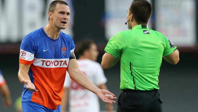 FC Cincinnati defender Austin Berry (22) talks to the referee after a yellow card was issued in the first half during the USL soccer match between the New York Red Bulls II and FC Cincinnati, Saturday, Sept. 16, 2017, at Nippert Stadium in Cincinnati.