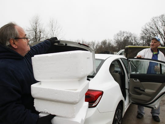 Tim Cote helps Scott Phillips, right, of Grand Ledge unload foam from his car Dec. 2.  Cote has worked part-time at the Grand Ledge recycling center for the past 14 years.   The center is could be closed by next fall.
