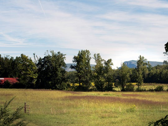This view of the Whippoorwill Farm shows Shortoff Mountain visible in the distance. Foothills Conservancy has donated the historic farm property to the state of North Carolina as part of Lake James State Park.