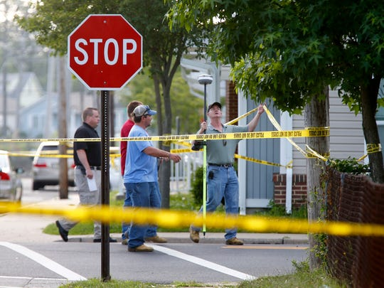 Investigators gather at Central and Liberty Street in Long Branch Monday morning, July 17, 2017, near the scene of a possible homicide.