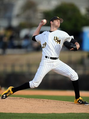 University of Southern Mississippi player Christian Talley (29) pitches the ball during the first game of the season for the Golden Eagles at Pete Taylor Park Friday.