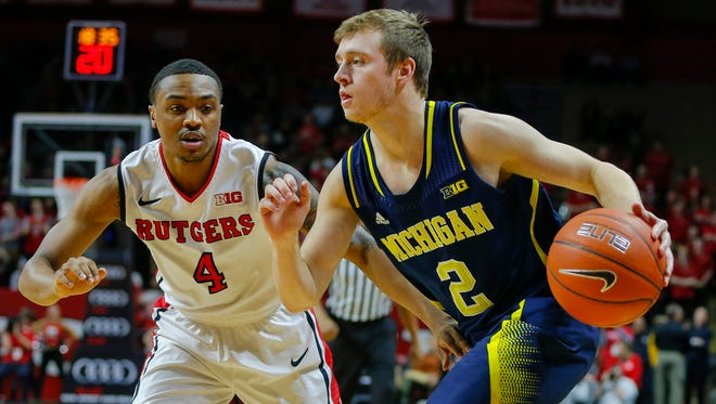 Jan 20, 2015; Michigan Wolverines guard Spike Albrecht (2) drives to the basket against Rutgers Scarlet Knights guard Myles Mack (4).