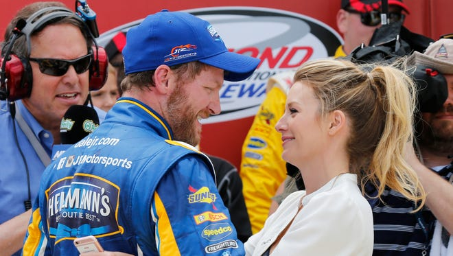 Dale Earnhardt Jr. gets a hug from his fiancee Amy Reimann as he celebrates winning the Xfinity series auto race Saturday at Richmond International Raceway.