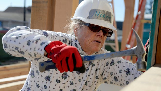 Mickie Grimaldi, with the Moorpark Women's Fortnightly Club, volunteers at a Habitat for Humanity of Ventura County project in Oxnard. The organization recently launched a new program to help Thomas Fire victims repair their homes.