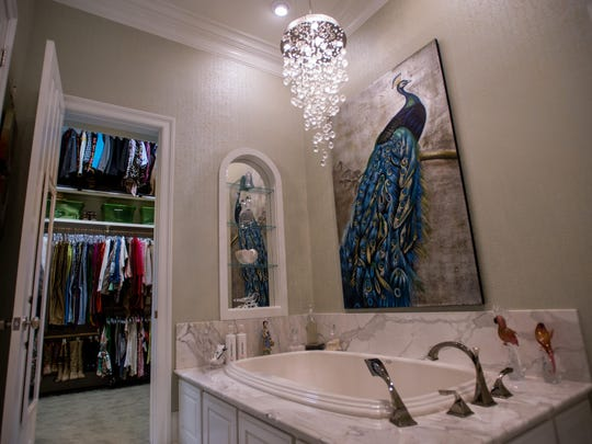 The luxurious bathroom leads into the massive walk-in closet of Virginia Stokes, pictured in Lafayette, La., Thursday, Nov. 5, 2015.