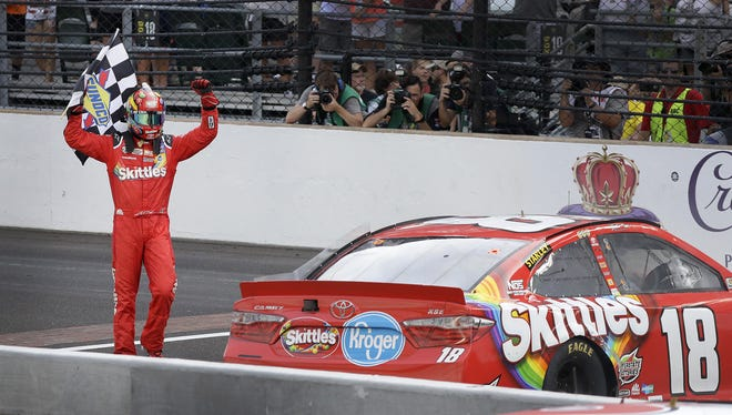 Sprint Cup Series driver Kyle Busch (18) celebrates winning the Brickyard 400 Sunday, July 24, 2016, afternoon at the Indianapolis Motor Speedway.