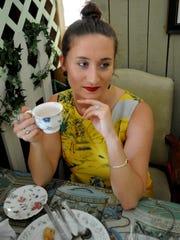 Alice Kuhn sips her tea at the Highland Jazz Brunch