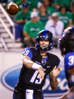 MTSU quarterback John Urzua makes a throw against Marshall on Friday, Oct. 20, 2017, in Murfreesboro, Tenn.