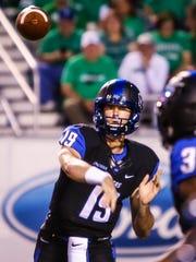 MTSU quarterback John Urzua makes a throw against Marshall