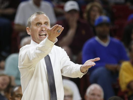 Arizona State head basketball coach Bobby Hurley argues
