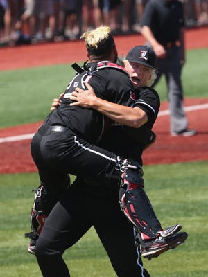 U of L catcher Colby Fitch (42) jumped into the arms of Sam Bordner (13) after they beat UK 6-2 in the super regional at Patterson Stadium.June 10, 2017