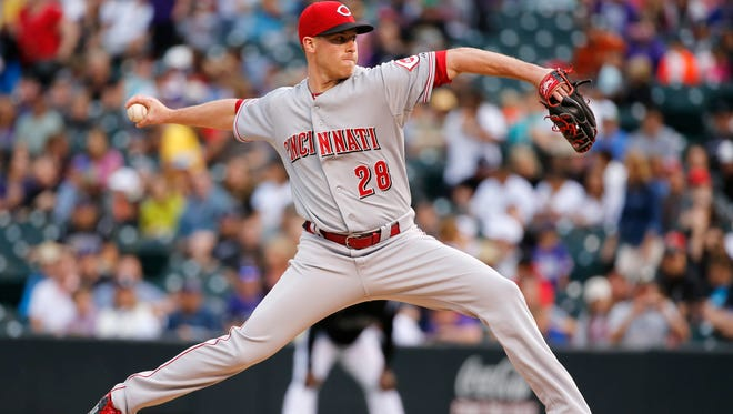 Reds starting pitcher Anthony DeSclafani throws against the Colorado Rockies during the first inning Friday in Denver.