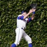 Chicago Cubs rightfielder Nate Schierholtz catches a fly ball June 8, 2014, in Chicago.