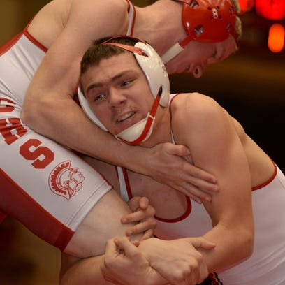Richmond's Xavier O'Brien, top, wrestles Union County's Cole Bowers during a meet in Liberty Wednesday, Dec. 3, 2014.