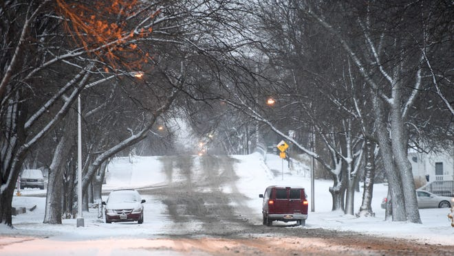 Snow and slush cover Summit Avenue in Sioux Falls on Monday, Jan. 22, 2018. A snow storm hit southeastern South Dakota on Sunday night, dropping up to six inches of snow in some areas.