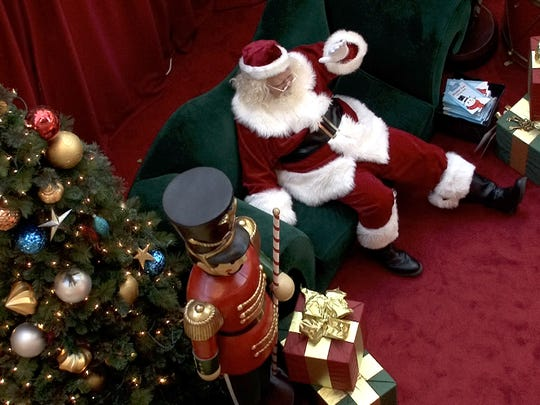Santa Claus waits for children to visit at the Freehold Raceway Mall.