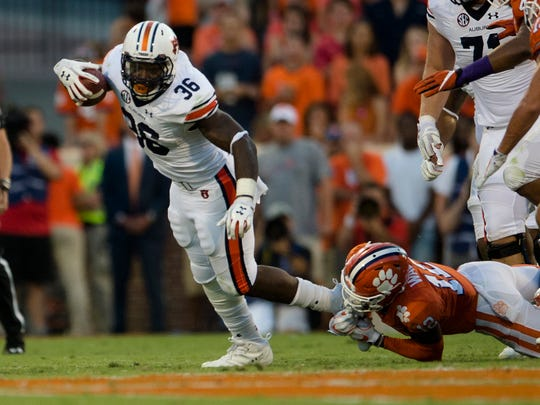 Auburn running back Kamryn Pettway (36) breaks a tackle during the NCAA football game between Auburn and Clemson on Saturday, Sept. 9, 2017, in Clemson N.C.