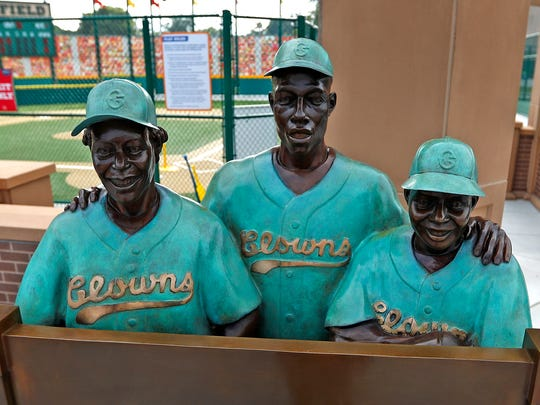 "Three members of the Indianapolis Clowns, Toni Stone, from left, Hank Aaron, and Mamie ""Peanut"" Johnson, are portrayed in one of the new bronze statues of iconic Indiana sports legends to be unveiled Tuesday, July 24, 2018, in the Riley Children's Health Sports Legends Experience area at the Children's Museum of Indianapolis."