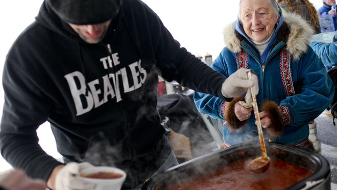 Helen Niles of Port Huron waits as Joe Welker of the Atrium Café and Ice Cream Parlor serves chili during the 2014 ChillyFest  JEFFREY SMITH/TIMES HERALD